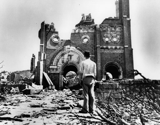 This powerful photograph, Redress, features a man by the remains of a Cathedral in Urakami, left after the nuclear bomb in 1945.